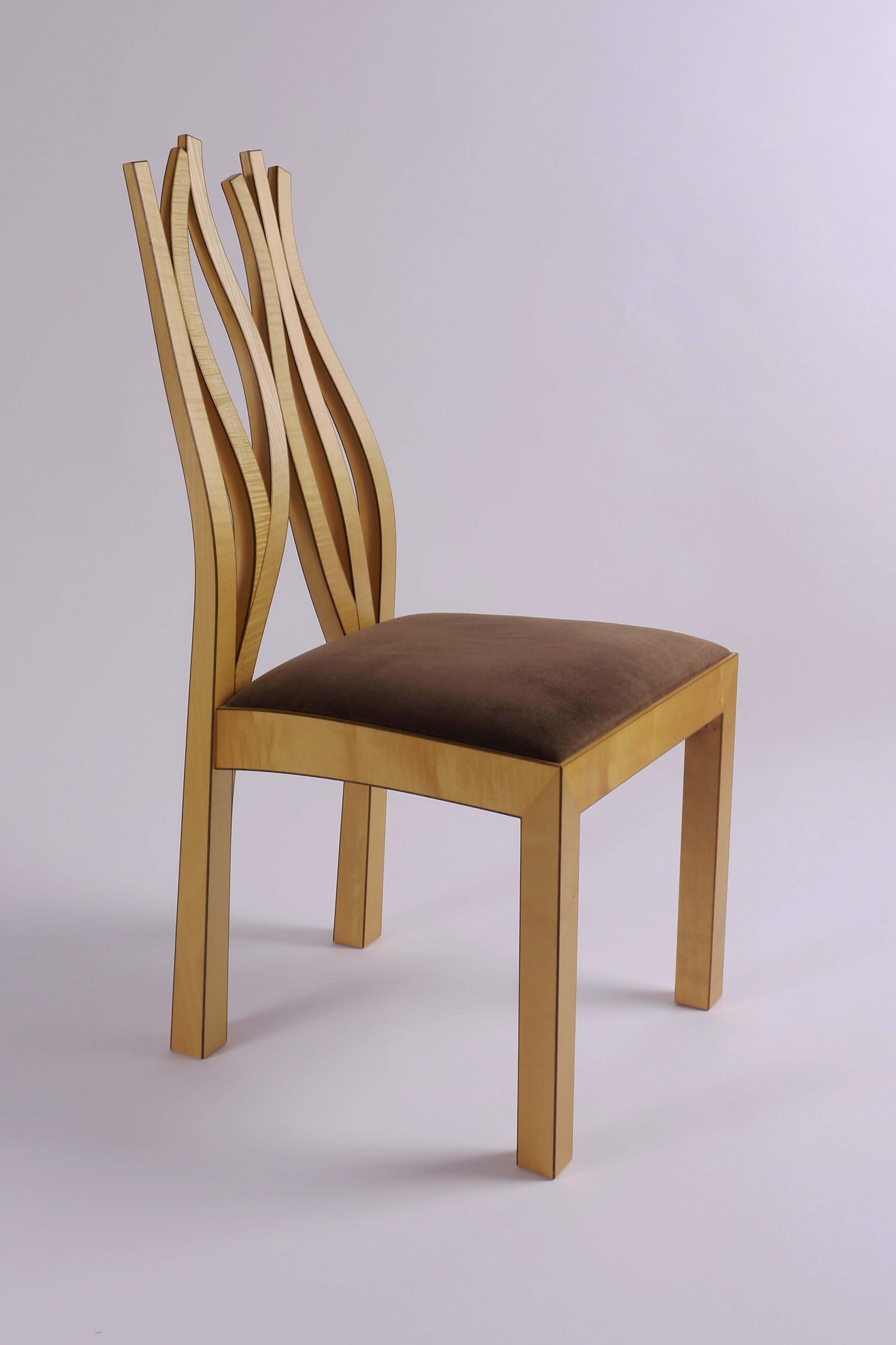 Chair (one of twelve) made out of solid sycamore with American back walnut edge detail.