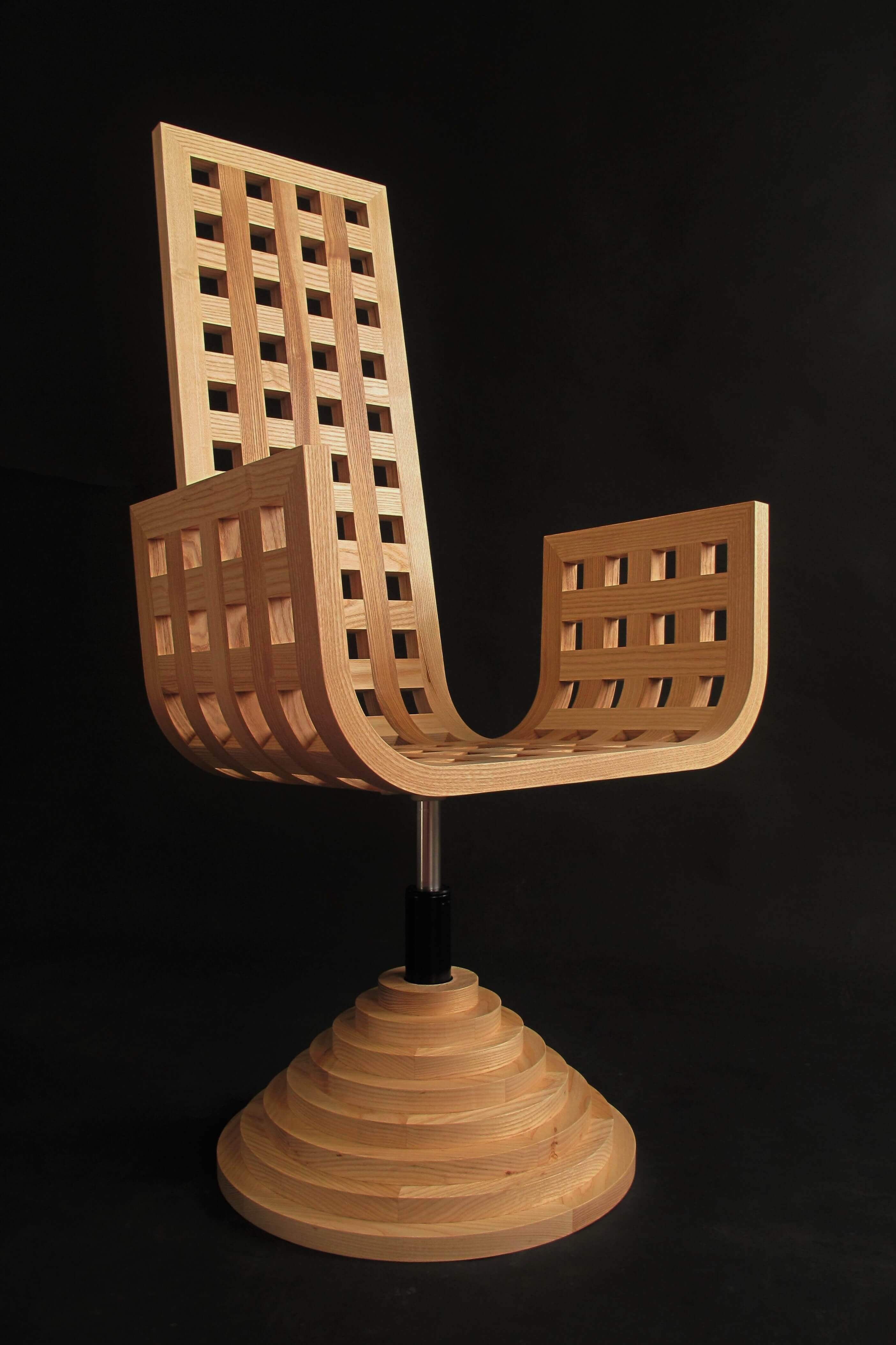 Chair (one of a pair) made out of steam bent ash. Each piece is linked together by means of a cross-halving joint.