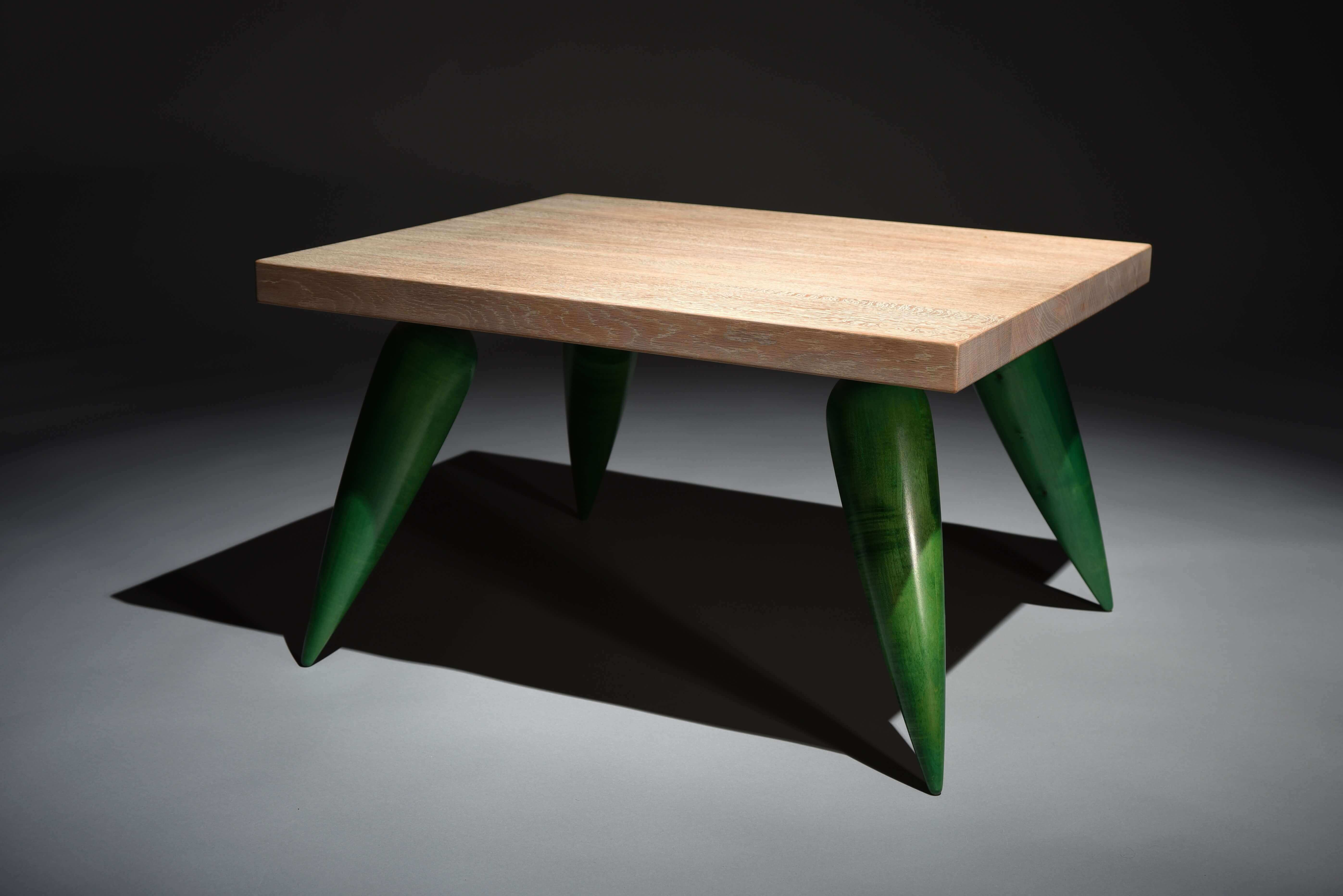 Low table. Top made out of limed oak on stained green legs. bespoke furniture.